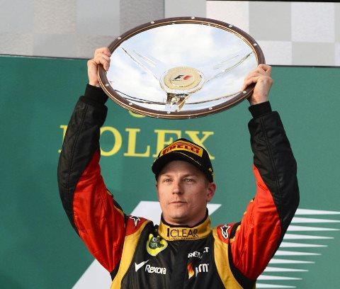 F1-2013-AUSTRALIE-MELBOURNE-KIMI-RAIKKONEN-1er-sur-le-PODIUM-du-GP-AUSTRALIE