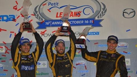 ALMS-2013-PETIT-LE-MANS-LES-pilotes-REBELION-sur-le-podium.