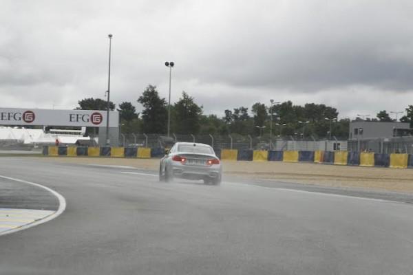 LE-MANS-CLASSIC-2014-Tour-du-circuit-en-BMW-avec-Yannick-DALMAS-Dimanche-6-juillet-Apres-le-virage-du-karting-Photo-Thierry-COULIBALY