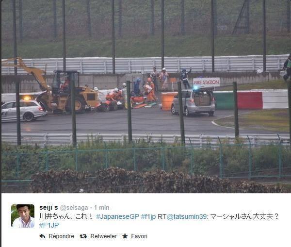F1-2014-SUZUKA-Les-SECOURISTES-s'affairent-autour-de-Jules-BIANCHI.