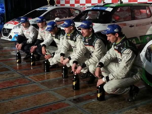 RALLYE-DU-VALAIS-2014-Les-trois-équipages-vainqueurs-sur-le-podium-final-Photo-Jean-Francois-THIRY.
