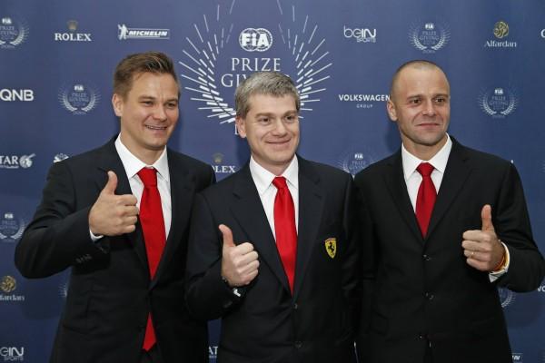 FIA-2014-Remise-des-Prix-a-DOHA-au-QATAR-Les-pilotes-de-la-SCUDERIA-AF-CORSE-CHAMPIONS-du-Monde-GT-Tony-VILANDET-et-Gianmaria-BRUNI-avec-leur-Team-manager