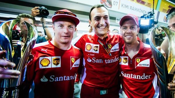 F1 2015 SINGAPOUR SEB VETTEL ET KIMI RAIKKONEN DEUX PILOTES FERRARI HEUREUX.
